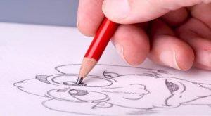 Person som ritar en seriefigur på ett opapper
